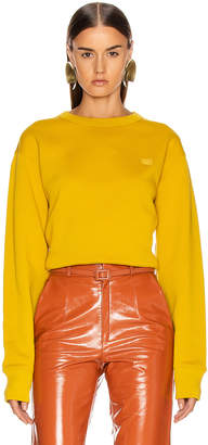Acne Studios Fairview Face Sweatshirt in Amber Yellow | FWRD