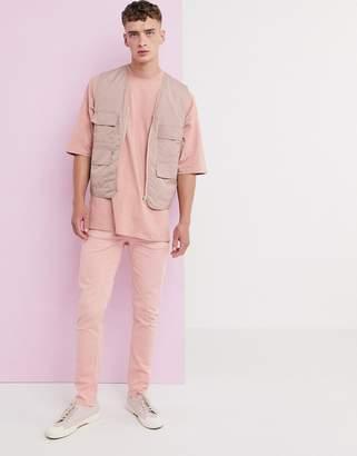 Asos Design DESIGN skinny jeans in pastel pink