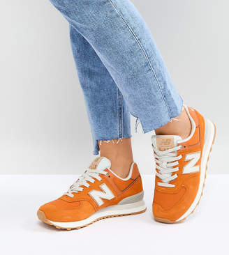 New Balance 574 Suede Trainers In Orange