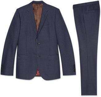 Monaco striped suit $2,490 thestylecure.com