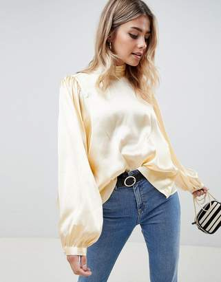 bba234a9f61d1 Asos Design DESIGN long sleeve satin blouse with high neck and open back
