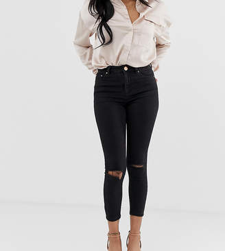 63679241148c25 Asos DESIGN Petite Ridley high waisted skinny jeans in clean black with  ripped knees