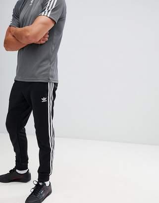 adidas Superstar Skinny joggers cuffed in black cw1275