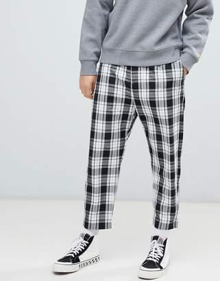 Bershka loose fit check pants in black with elastic waist
