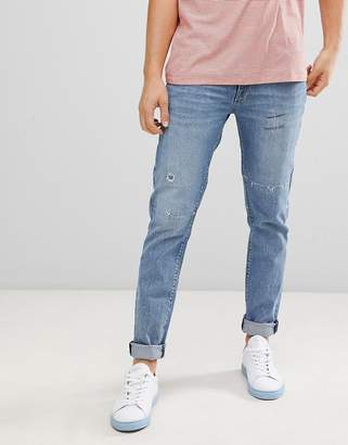 ce96674f900 Asos Design DESIGN super skinny jeans in vintage mid wash with rip and  repair