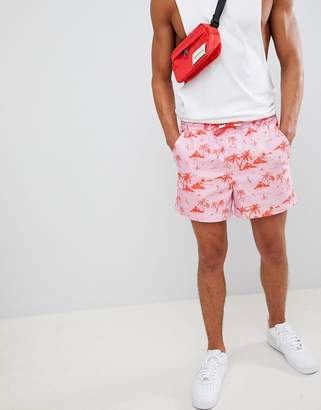 Asos Design DESIGN slim shorts with elasticated waistband in pink tropical print