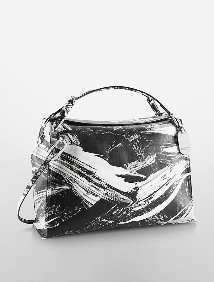 Calvin KleinCalvin Klein Womens Platinum Edged Brushstroke Leather Satchel Black/White