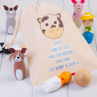 at Notonthehighstreet.com · British and Bespoke Childrenu0027s Wooden Farm Animal Skittles Personalised Bag & Toy Storage Bags - ShopStyle UK