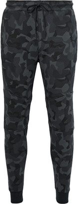 Nike Tapered Camouflage-Print Cotton-Blend Tech Fleece Sweatpants $130 thestylecure.com