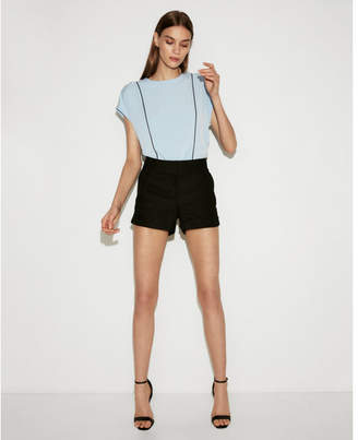 Express piped zip back crew neck blouse