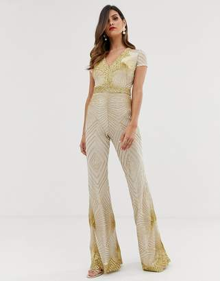 Goddiva plunge front sequin jumpsuit with flared leg in white and gold