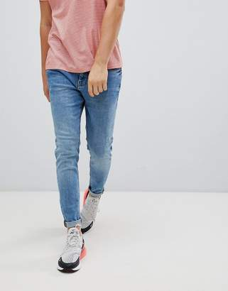 Pull&Bear carrot fit jeans in mid blue