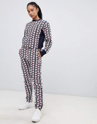 Champion tracksuit bottoms in all over print reverse weave two-piece