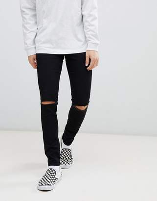 Cheap Monday super skinny jeans in black with knee rip