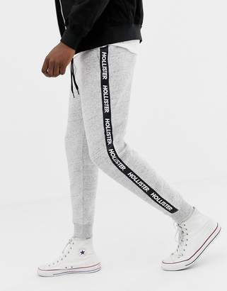 Hollister side taped logo slim fit cuffed jogger in gray marl