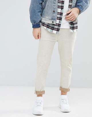 Asos DESIGN Tapered Jeans In Ecru Nep