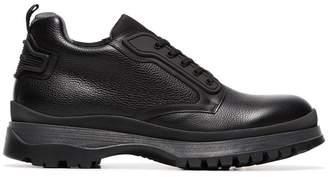 Prada Brixxen Logo Embossed Leather Boots