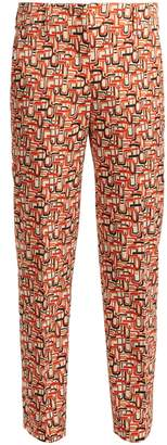 Prada U-print tailored wool-blend trousers