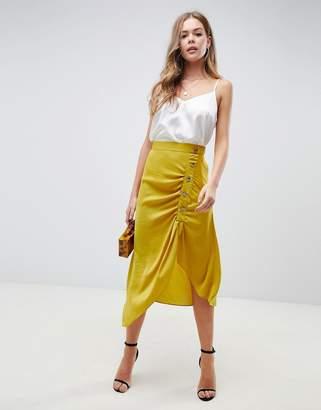 Asos Design DESIGN satin midi skirt with popper front