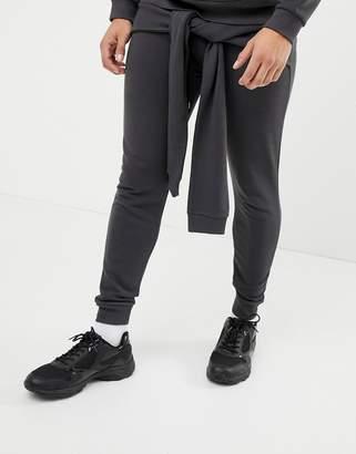 Asos DESIGN skinny joggers with tie around detail