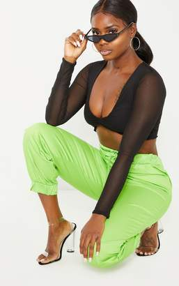 d4d6cef1fe2dad PrettyLittleThing Petite Neon Lime Ruched Front Long Sleeve Mesh Crop Top