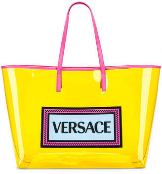 Versace Clear Vinyl Logo Tote in Yellow   FWRD