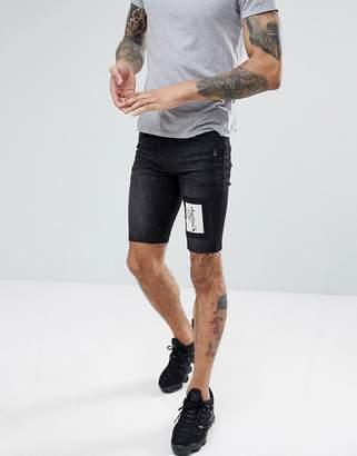 Religion Skinny Fit Denim Shorts In Black With Skeleton Patch