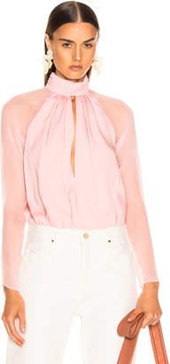 Fleur Du Mal Long Sleeve Keyhole Bodysuit in Coral Blush | FWRD