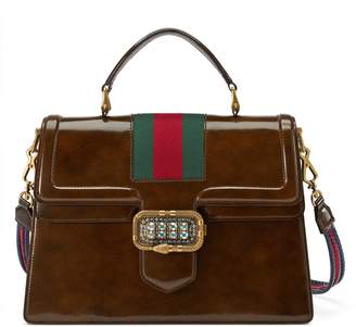 7822525c4579 Free Ground Shipping at Gucci · Gucci Medium top handle bag