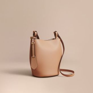 Burberry Leather and Haymarket Check CrossbodyBucket Bag $850 thestylecure.com