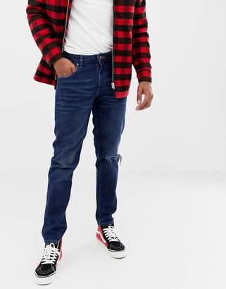 Asos DESIGN 14oz heavy weight slim jeans in dark wash blue with abrasions