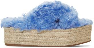 Miu Miu Blue Eco Fur Cross Sandals $590 thestylecure.com