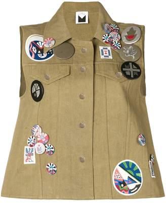 Sadie Williams sleeveless denim jacket with badges
