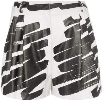 Moschino paint print leather shorts