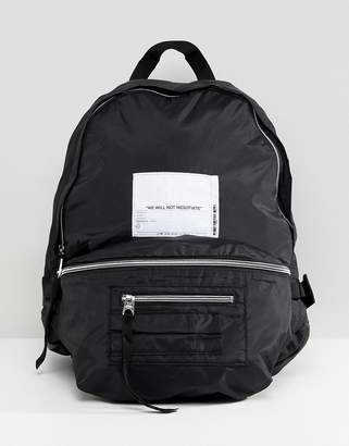 Cheap Monday multi pocket backpack with patch