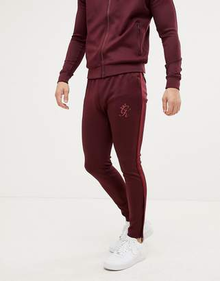 Gym King taped tracksuit bottoms in wine