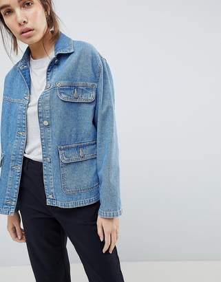 Asos DESIGN denim trucker jacket in midwash blue