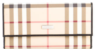 Burberry Leather-Trimmed Nova Check Wallet $145 thestylecure.com