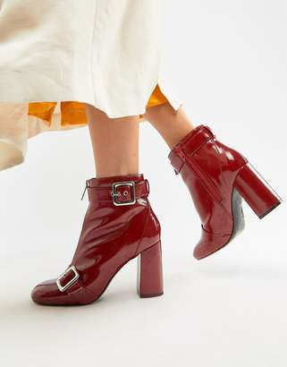 Miss Selfridge patent heeled boots with buckle detail in red