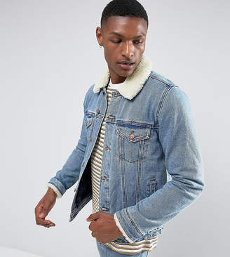 Asos DESIGN Tall denim jacket with fleece collar in blue wash