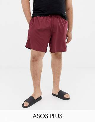 Asos DESIGN Plus swim shorts in burgundy mid length