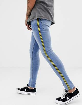 New Look super skinny jeans with mustard side stripe in blue wash
