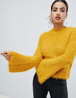 PrettyLittleThing flared sleeve fluffy sweater in yellow