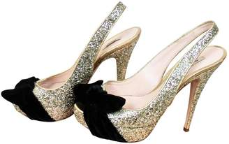 Miu Miu Gold Leather Heels