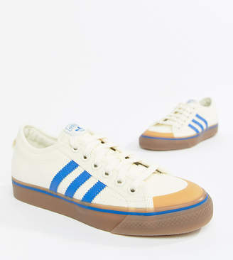 adidas Nizza Canvas Trainers In White And Blue