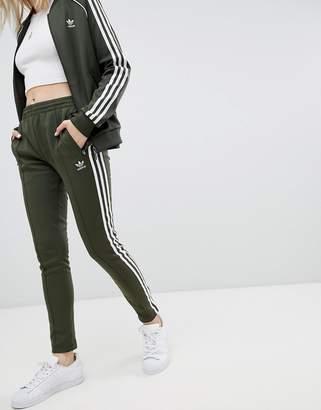 adidas Three Stripe Track Pants In Khaki