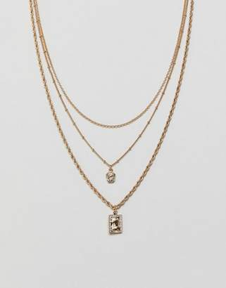 Icon Eyewear Asos Design ASOS DESIGN multirow necklace with vintage style pendants and mixed chains in gold