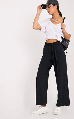 PrettyLittleThing Karrah Black Wide Leg Tie Front Ribbed Trousers