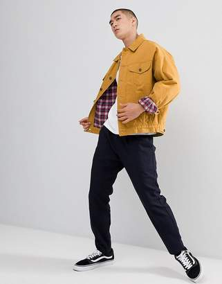 Asos Design DESIGN oversized denim jacket with check in mustard