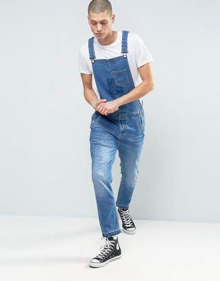 ASOS Denim Overalls With Abrasions And Raw Hem In Mid Blue $72 thestylecure.com